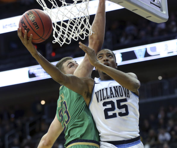 Notre Dame's Martinas Geben (23), of Lithuania, tries to block a shot by Villanova's Mikal Bridges (25) during the first half of an NCAA college basketball game Saturday, Dec. 10, 2016, in Newark, N.J. (AP Photo/Mel Evans)