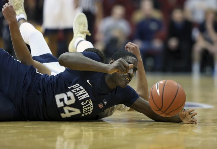 ASSOCIATED PRESS Penn State's Mike Watkins (24) grabs the ball as he collides with Pittsburgh's Cameron Johnson, back, (23) during the second half Saturday in Newark, N.J.