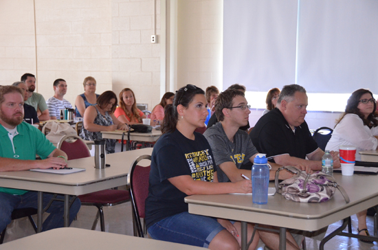 In this July 18, 2016, photo, people attend a continued education faculty and staff training at United High School in Clarksburg, W.Va. Employees in the Harrison County School District are choosing to be lifelong learners through continuing education, remaining up-to-date on the newest information, technology and instructional strategies. (Kailee Gallahan/The Exponent via AP)