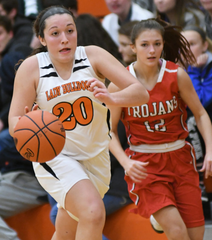 Jersey Shore's Hannah Kauffman (20) brings the ball down the floor on a fast break after stealing the ball from Troy's Madison McClelland in the third quarter Monday at Jersey Shore.
