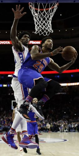 New York Knicks' Derrick Rose (25) goes up for a shot against Philadelphia 76ers' Joel Embiid (21) during the second half of an NBA basketball game, Wednesday, Jan. 11, 2017, in Philadelphia. Philadelphia won 98-97. (AP Photo/Matt Slocum)