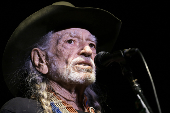 In this Jan. 7, 2017 photo, Willie Nelson performs in Nashville, Tenn. The 83-year-old outlaw country icon wants to help a lot of people give marijuana a try. HeÕs attached his name to a line of legal marijuana being sold in Colorado and Washington called ÒWillieÕs Reserve,Ó after decades of personally advocating for the legalization of marijuana.  (AP Photo/Mark Humphrey)