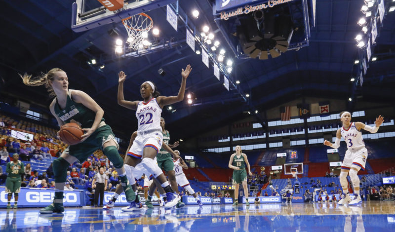Baylor guard Kristy Wallace, left, prepares to pass defended by Kansas guard Chayla Cheadle (22) during an NCAA college basketball game Sunday, Jan. 15, 2017, in Lawrence, Kan. (AP Photo/Mike Yoder)