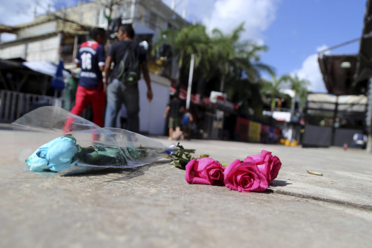 ASSOCIATED PRESS Roses lay outside the Blue Parrot nightclub after a shooting Monday in Playa del Carmen, Mexico. The shooting occurred in the early morning hours outside the nightclub while it was hosting part of the BPM electronic music festival, according to police.