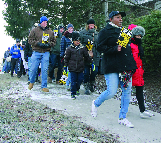 Supporters of all walks and generations turned out for the 10th annual Martin Luther King Day Peace Walk that began at Lycoming College Monday morning. ANNE REINER/Sun-Gazette