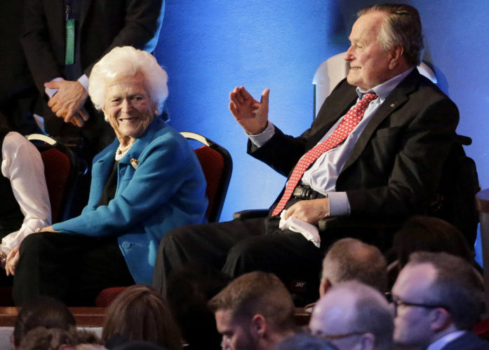 ASSOCIATED PRESS FILE PHOTO Former President George H. W. Bush, right, and his wife, Barbara, are greeted on Feb. 25, 2016, before a Republican presidential primary debate at The University of Houston. On Wednesday, the former president was admitted to an intensive care unit, and Barbara was hospitalized as a precaution, according to his spokesman.