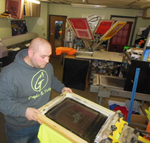 MIKEREUTHER/Sun-Gazette Will Guinter, owner of G3 Graphics and Printing, works on a project at his Muncy business.