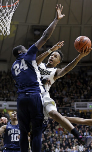 Purdue forward Vince Edwards (12) shoots around Penn State forward Mike Watkins (24) in the second half of an NCAA college basketball game in West Lafayette, Ind., Saturday, Jan. 21, 2017. Purdue defeated Penn State 77-52. (AP Photo/Michael Conroy)