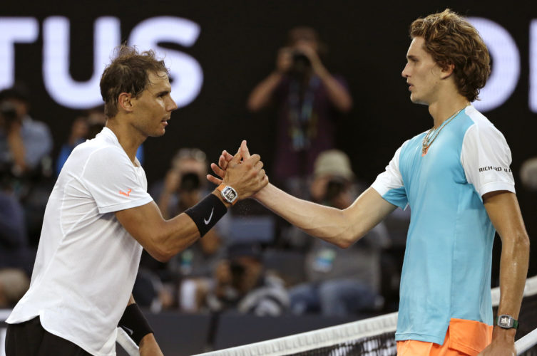 Spain's Rafael Nadal, left, is congratulated by Germany's Alexander Zverev after winning their third round match at the Australian Open tennis championships in Melbourne, Australia, Saturday, Jan. 21, 2017. (AP Photo/Dita Alangkara)