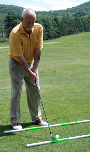 A good golf swing starts with a proper stance and grip.