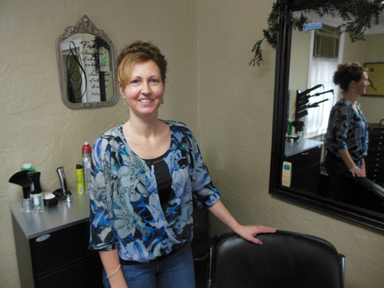 MIKE REUTHER/Sun-Gazette Brenda Jennings stands next to a chair at her salon on Lycoming Creek Road.