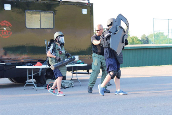 A 2016 Camp Cadet participant is shown during a Special Response Team (SRT) demonstration.
