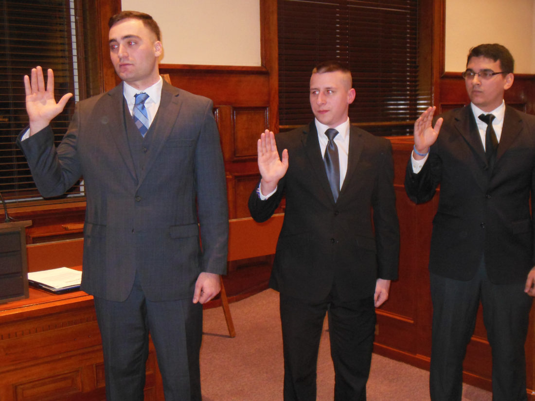 MARK MARONEY/Sun-Gazette New city police hires taking the oath of office Thursday at City Council meeting, left to right, are Thaddaeus Paul Trafford, 25, Addison Timothy Gingrich, 24, and Gino Vincent Caschera, 22.