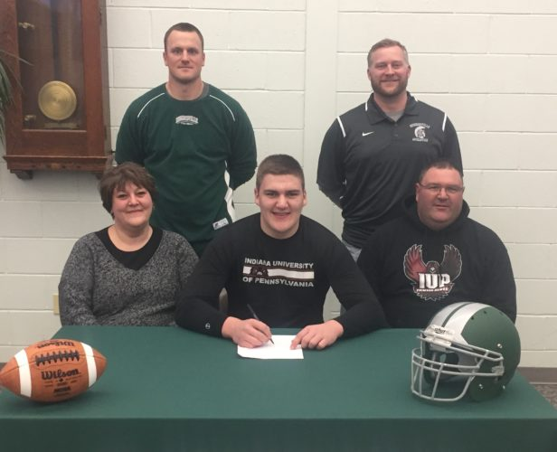 Hughesville's Josh Dauberman signed his letter of intent to play football at Indiana University of Pennsylvania. Seated on opposite sides of Dauberman are his mother, Christine (left) and father, Chris. Standing are Hughesville football coach Dan Tucker, left, and Hughesville athletic director Kevin Steele. (PHOTO PROVIDED)