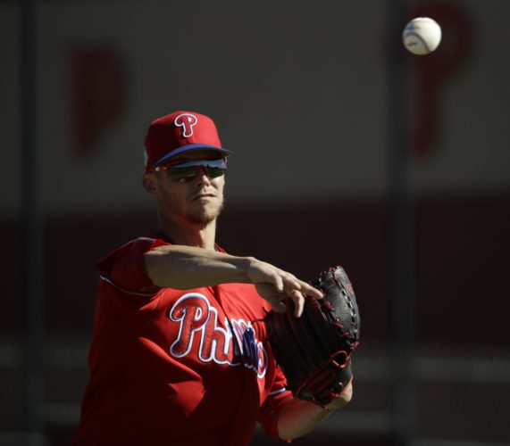 Philadelphia Phillies' Clay Buchholz throws to first base during a spring training baseball workout Thursday, Feb. 16, 2017, in Clearwater, Fla. (AP Photo/Matt Rourke)