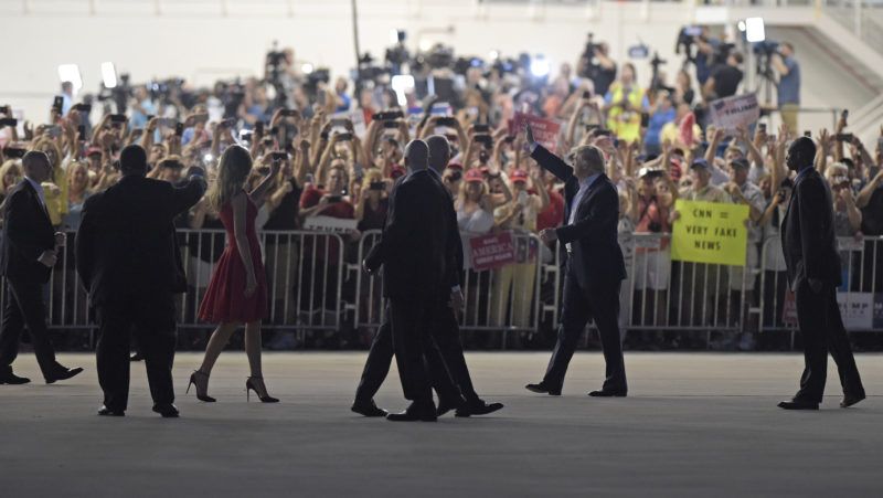 "ASSOCIATED PRESS President Donald Trump, second from right, and first lady Melania Trump, third from left, wave to the crowd following the ""Make America Great Again Rally"" Saturday at Orlando-Melbourne International Airport in Melbourne, Fla."