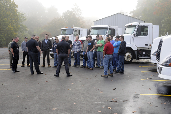 PHOTO PROVIDED Amid six trucks that were donated in the past year, FedEx Freight representatives and Penn College faculty gather outside the Schneebeli Earth Science Center to share career advice with diesel technology students.