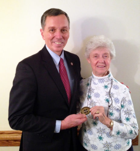 PHOTO PROVIDED Fran Hendricks, Mansfield University president, left, presents the Presidential Coin for Excellence to Ada Mae Saxton.