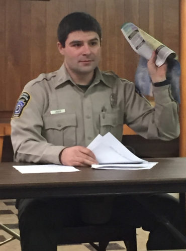 SETH NOLAN/Sun-Gazette Waterways Conservation Officer Chad Lauer introduces himself at a meeting of the Susquehanna Chapter of Trout Unlimited.