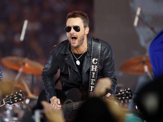 FILE - In this Thursday, Nov. 24, 2016, file photo, Country music singer Eric Church performs at halftime during an NFL football game between the Washington Redskins and Dallas Cowboys in Arlington, Texas. Church has been battling ticket scalpers for years as his popularity grew and he began selling out arenas. But heÕs taken his biggest step yet by canceling more than 25,000 tickets to his spring tour that were purchased by scalpers and putting them back on sale for fans to purchase. (AP Photo/Ron Jenkins, File)