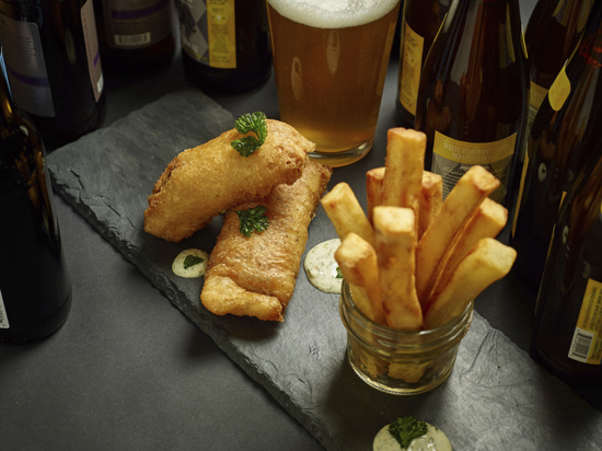 This Feb. 14, 2017 photo provided by The Culinary Institute of America shows fish and chips in Hyde Park, N.Y. This dish is from a recipe by the CIA. (Phil Mansfield/The Culinary Institute of America via AP)