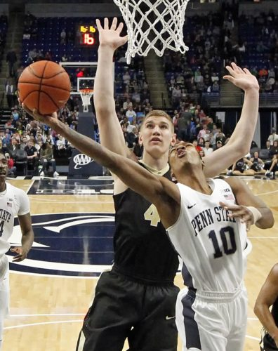 Penn State's Tony Carr (10) drives to the basket as Purdue's Isaac Haas (44) defends during the first half Tuesday at the Bryce Jordan Center.