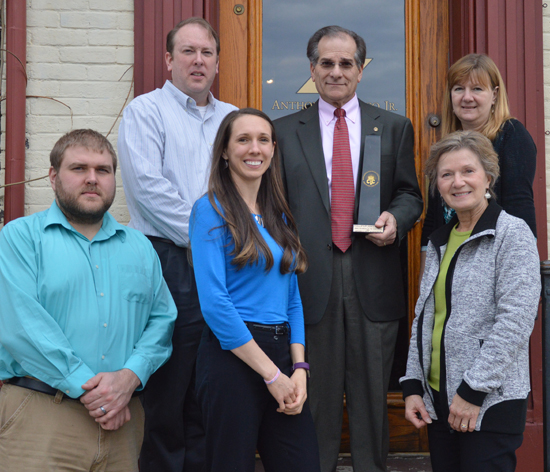 KATELYN HIBBARD/Sun-Gazette Anthony H. Visco Jr. Architects was  awarded the Phillips/Plankenhorn Small Business of the Year Award at the Williamsport/Lycoming Chamber of Commerce's 131st annual meeting and awards banquet Wednesday. Tony Visco Jr. and his team are pictured with the award outside his office on Market Street. At top, from left, are Eric Laughrey, Tony Visco Jr. and Pat Russell; below are Matt Strahan, Chelsea Rawson and Fran Visco.