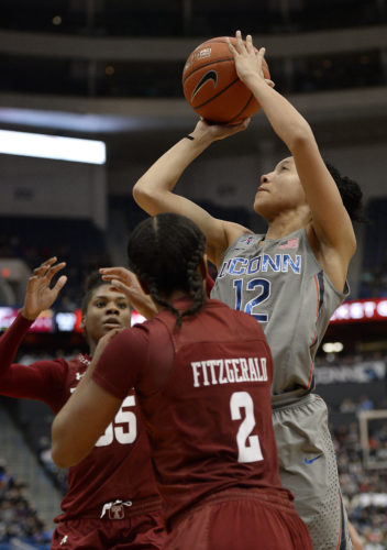 Connecticut's Saniya Chong shoots over Temple's Safiya Martin, rear and Feyonda Fitzgerald during the second half of an NCAA college basketball game, Wednesday, Feb. 22, 2017, in Hartford, Conn. (AP Photo/Jessica Hill)