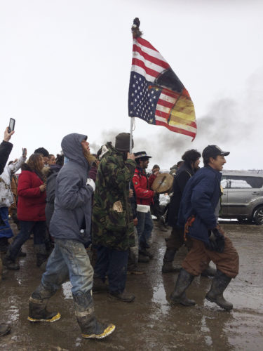 ASSOCIATED PRESS People peacefully leave the Dakota Access pipeline main protest camp near Cannon Ball, N.D., as authorities prepared to shut it down in advance of the spring flooding season. The Army Corps of Engineers ordered the camp closed at 2 p.m. Wednesday.