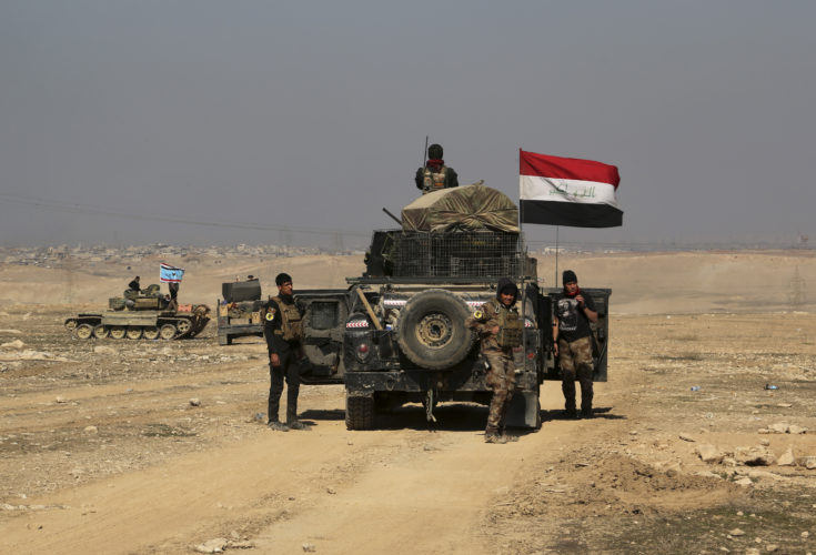 ASSOCIATED PRESS Iraqi special forces advance towards the western side of Mosul, Iraq, Thursday. The advance comes as part of a major assault that started five days earlier to drive Islamic State militants from the western half of Mosul, Iraq's second-largest city.