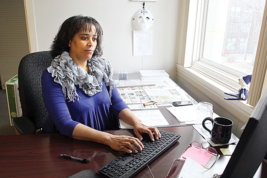 KAREN VIBERT-KENNEDY/Sun-Gazette Billing clerk Cathy Hendricks works in her office at the Williamsport Sun-Gazette's building on West Fourth Street.