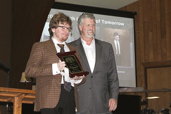 CHERYL R. CLARKE/Sun-Gazette Sam Finch, a senior at North Penn-Mansfield High School, received the Overall Youth Leader of Tomorrow award Feb. 27 during the annual banquet at New Covenant Academy. With him is Southern Tioga School District Superintendent Sam Rotella.