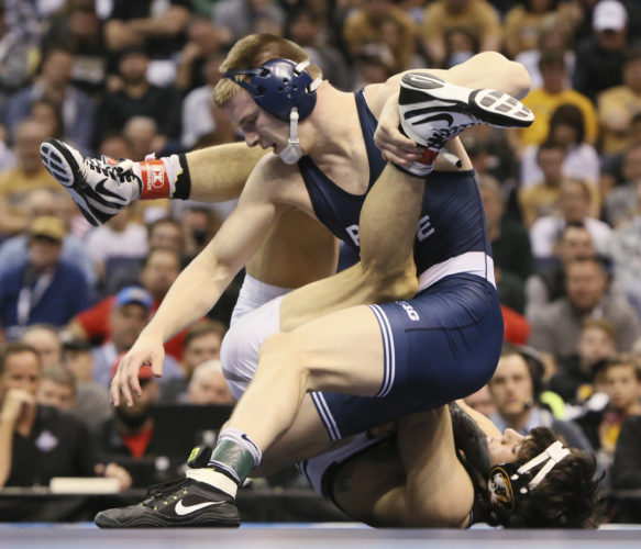 Penn State's Jason Nolf, top, wrestles against Missouri's Joey Lavallee  in their 157-pound title match Saturday in St. Louis.  ASSOCIATED PRESS