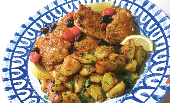 This photo shows Greek-style roasted lemon potatoes in New York. This dish is from a recipe by Sara Moulton. (Sara Moulton via AP)