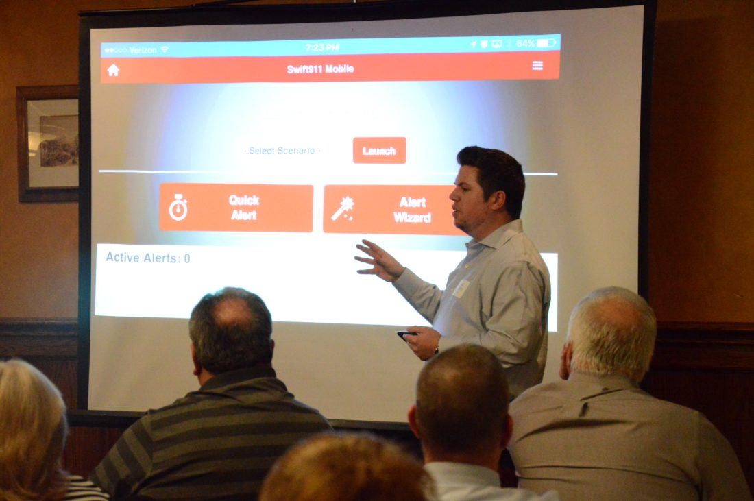 KATELYN HIBBARD/Sun-Gazette Chaz Garrity, of SwiftReach Networks, explains the county's new mass notification system, Swift911, during the Department of Public Safety's 40th annual Appreciation Dinner for emergency services personnel on Thursday at the Holiday Inn on Pine Street.