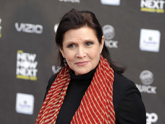 "This photo, shows Carrie Fisher at the 2011 NewNowNext Awards in Los Angeles. Disney CEO Bob Iger said on March 23, 2017, that Fisher's performance as Princess Leia in ""The Last Jedi"" remains unchanged. Fisher completed filming her role as Princess Leia in ÒThe Last JediÓ before her death following a heart attack in December. (AP Photo/Chris Pizzello, File)"