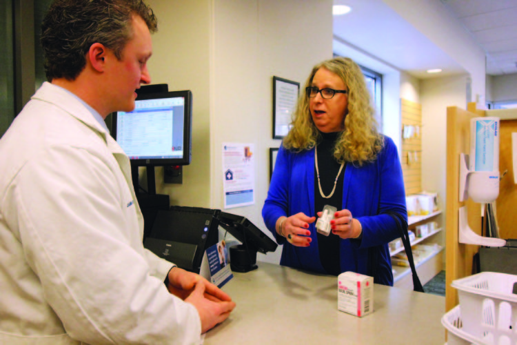 ANNE REINER/Sun-Gazette  Dr. Rachel Levine, state physician general, walks through a mock noloxone purchase at the UPMC Susquehanna Pharmacy with Ben Stanis, chief pharmacist, Friday afternoon.