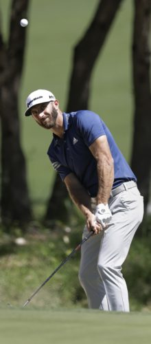 Dustin Johnson chips to the green on the seventh hole during quarterfinal play at the Dell Technologies Match Play golf tournament at Austin County Club, Saturday, March 25, 2017, in Austin, Texas. (AP Photo/Eric Gay)