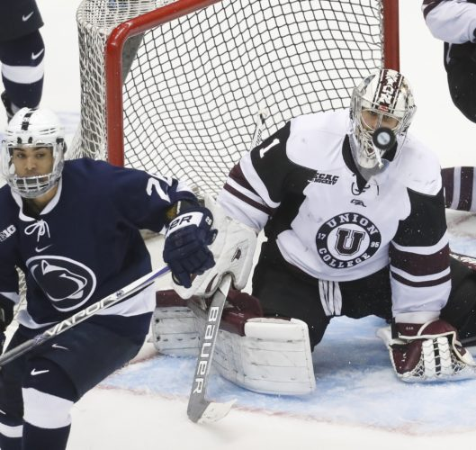 Union goalie Alex Sakellaropoulos (1) eyes the puck after making a save during the second period in the regional semifinals of the NCAA college hockey tournament against Penn State, Saturday, March 25, 2017, in Cincinnati. (AP Photo/John Minchillo)