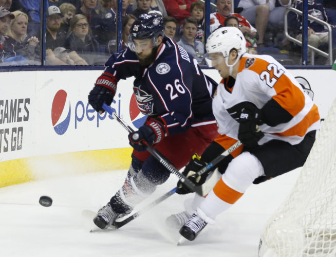 Columbus Blue Jackets' Kyle Quincey, left, clears the puck past Philadelphia Flyers' Dale Weise during the third period of an NHL hockey game Saturday, March 25, 2017, in Columbus, Ohio. The Blue Jackets beat the Flyers 1-0. (AP Photo/Jay LaPrete)