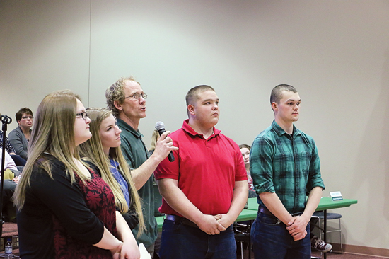 JOHN EATON/Sun-Gazette Correspondent Giving a PowerPoint presentation to the Wellsboro Area Board of Education about the high school's building construction program students building a house are teacher Drew Seeling (holding the microphone) and the high school's SkillsUSA Construction Club officers, from left, Katelyn Huck, secretary; Madison Gallo, treasurer; Seeling; Kyler Rice, vice president; and Zachery Kephart, president.