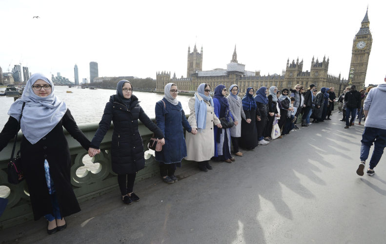 ASSOCIATED PRESS A group of women, some with their daughters, link hands on Westminster bridge in central London in an act of solidarity on Sunday organized by Women's March London to pay tribute to the victims of the Westminster attack.