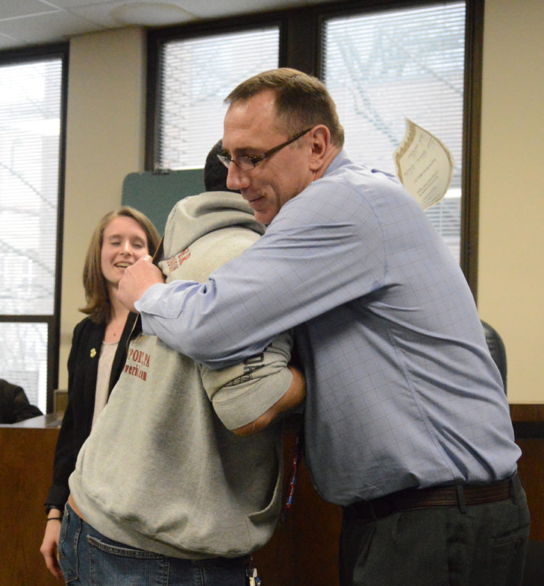 KATELYN HIBBARD/Sun-Gazette County Judge Mark F. Lovecchio hugs Montana Dunkleberger, who is one of three to graduate Tuesday from the county's unique Vivitrol Court, a program that helps opioid addicts get on the path to being clean.