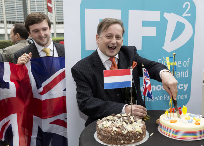 ASSOCIATED PRESS Britain's UK Independence Party Member of Parliament Ray Finch, right, celebrates the official triggering of Article 50 of the Lisbon Treaty in Brussels on Wednesday.