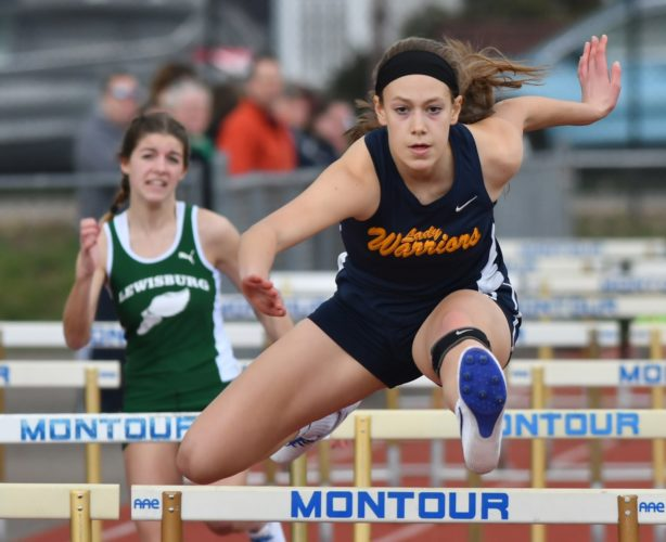 MARK NANCE/Sun-Gazette Montoursville's Caroline King holds the lead with two hurdles left in the girls 100 hurdles during a track meet vs Lewisburg Tuesday. King won the event. Lewisburg won both the boys and girls team events.