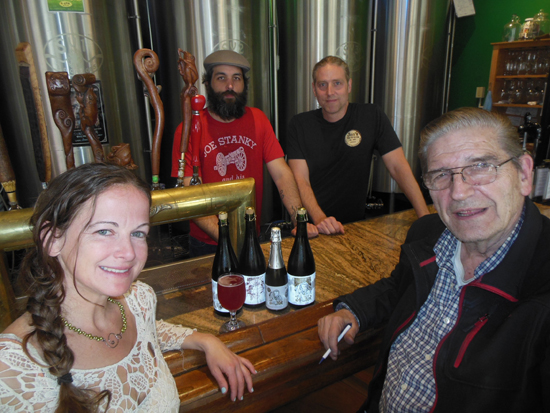 MIKEREUTHER/Sun-Gazette From left, Alicia Koch, Nate Saar, Steve Koch and Bob Koch gather around the bar, with its seven top-25 beers, at Bullfrog Brewery.
