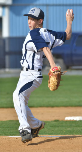 MARKNANCE/Sun-Gazette Muncy's Christian Good warms up between innings last week in a game against Sullivan County.