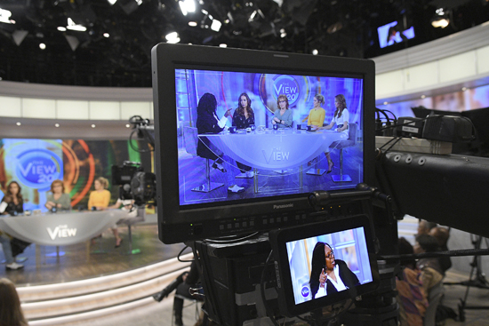 """In this photo released by ABC, co-hosts, from left, Whoopi Goldberg, Sunny Hostin, Joy Behar, Sara Haines and Jedediah Bila appear on a monitor during a broadcast of """"The View,"""" in New York. The unquenchable thirst for chatter about President Donald Trump has changed the dynamics of a fierce daytime television competition much as it has in late-night TV. """"The View"""" has spent more time talking politics with the arrival of a new administration, stopping the momentum of its rival """"The Talk,"""" which sticks to pop culture. (Lorenzo Bevilaqua/ABC via AP)"""