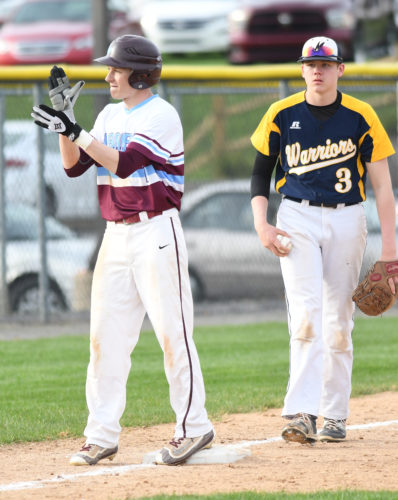MARK NANCE/Sun-Gazette Loyalsock's Chase McNulty celebrates after hitting a triple in the third inning. At right is Montoursville's Gabe Phillips.