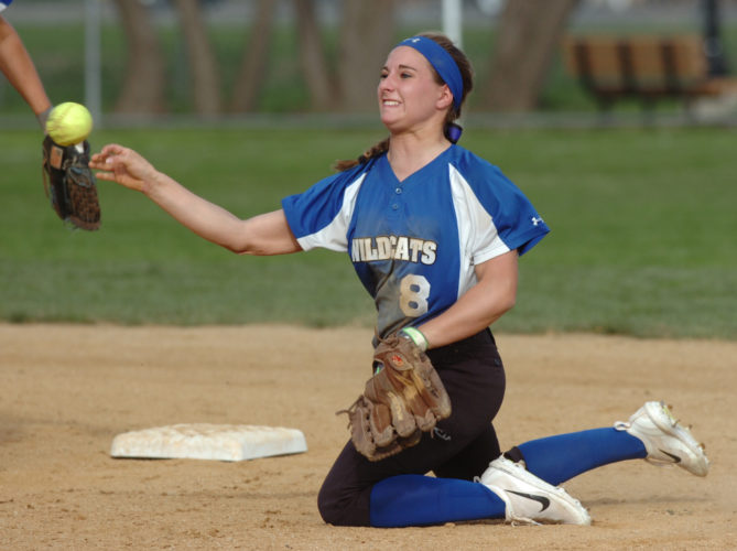 MARK NANCE/Sun-Gazette Central Mountain second baseman Josie Dershem throws to first after making a stop on a single by Jersey Shore's Alyssa Stover in the first inning on Tuesday at Jersey Shore.